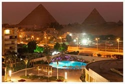 A view of the Le Meridien Hotel with the Giza Pyramids in the background. Most Egyptologists believe that the Giza Pyramids were built to be tombs for the ancient Egyptian pharaohs.