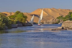 Felucca sailing down the Nile in Aswan. Sailing around the Aghakhan and the Old Cataract Hotel.