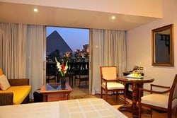 Located 700 meters from these wonders of the ancient world, Mena House offers unmatched views of the pyramids. You can gaze upon the magnificence of the pyramids from your rooms at sunrise and sunset. After dinner at one of the many restaurants, you can return to your room and see them lit up for your private viewing pleasure
