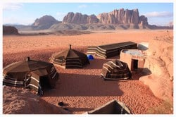 Wadi Rum also known as The Valley of the Moon is a valley cut into the sandstone and granite rock in southern Jordan 37 miles to the east of Aqaba; it is the largest wadi in Jordan