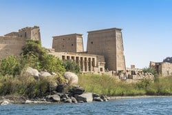 Philae temple is located in Aswan, about 560 miles south of the Great Pyramids and 140 miles south of King Tut tomb.  The temple of Goddess Isis or Philae is considered to be a hidden gem in Upper Egypt; the history of the temple goes back to the 7th century BC.In 1971, The United Nations with UNESCO helped Egypt to save the temple after the Egyptians built the High Dam