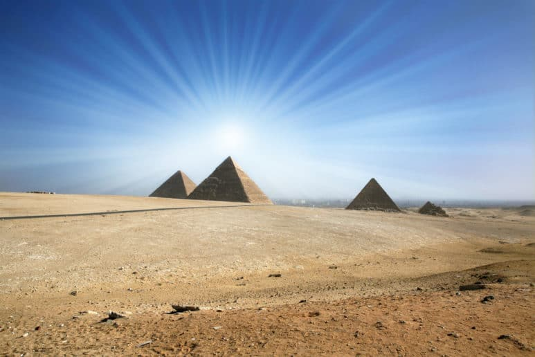 Light of the sun in the sky over the Great Pyramids of Giza.