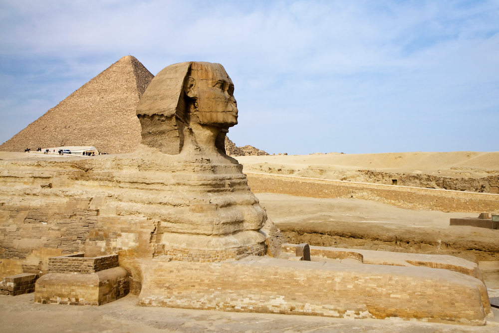 Ancient Egyptian Sphinx with the Great Pyramid in Giza