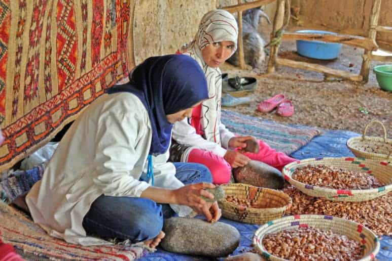 Women work in a cooperative for the manufacturing of argan fruits