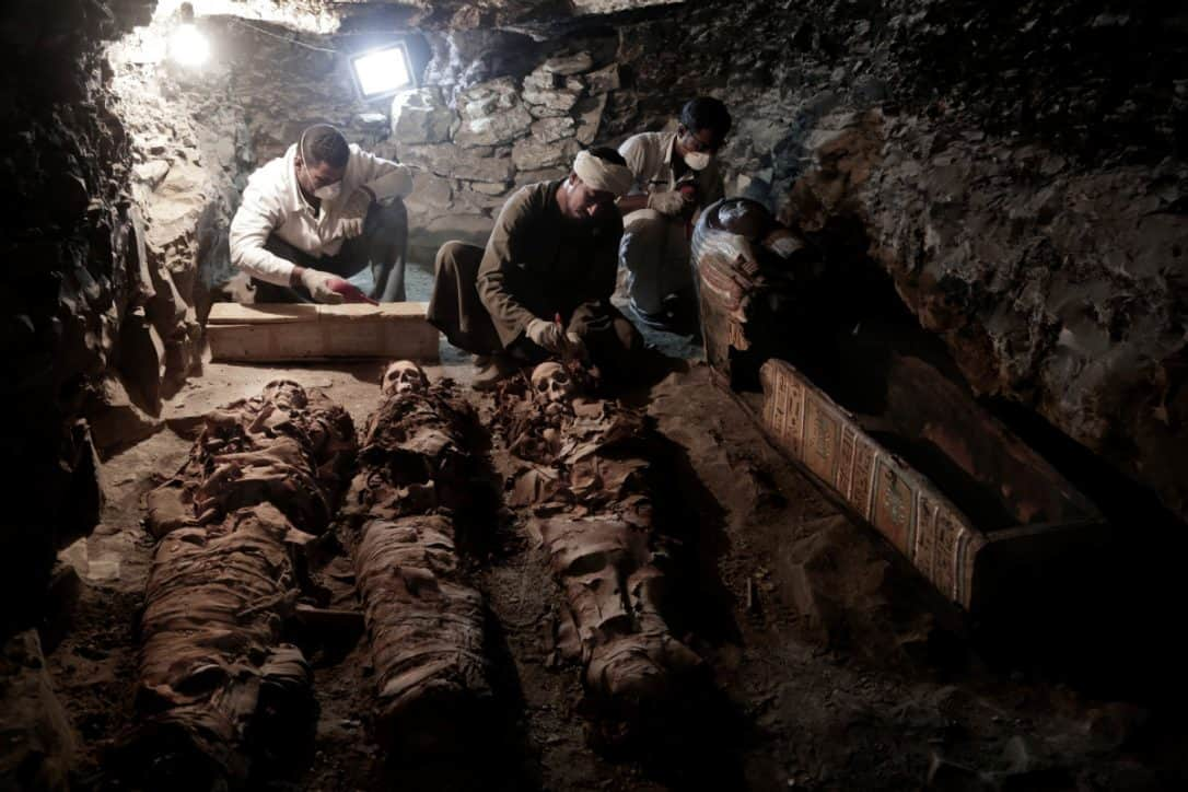 Workers cleaning up the mummies in the new tomb