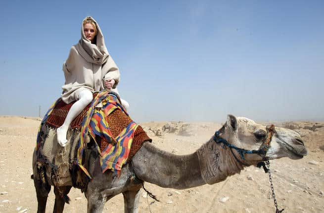 Traveler on a Camel by the Great Pyramids and Sphinx