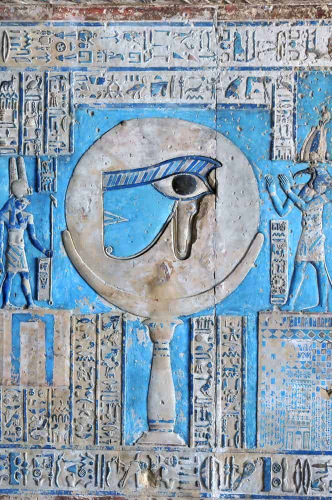 Beautiful painted relief of the sacred eye of horus at the ancient Egyptian temple of the goddess Hathor at Dendera, in Egypt