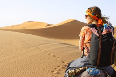 Woman riding in the Sahara Desert in Morocco